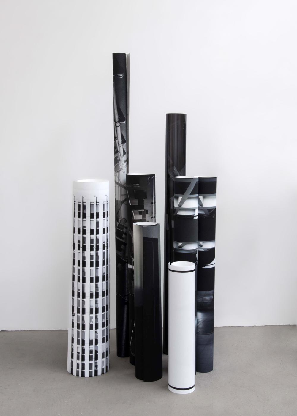 """Laura Rives, """"membrane souche"""".  Vue d'installation. Digigraphie sur papiers mat, semi brillant, dos bleu, brillant, enroulés. Dimensions variables. isdaT, Toulouse, 2013."""